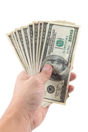 hand holds hundreds of dollars